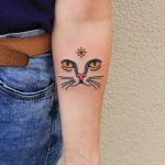Face of a cat tattoo