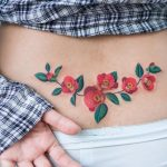 Flower tattoo on the lower back