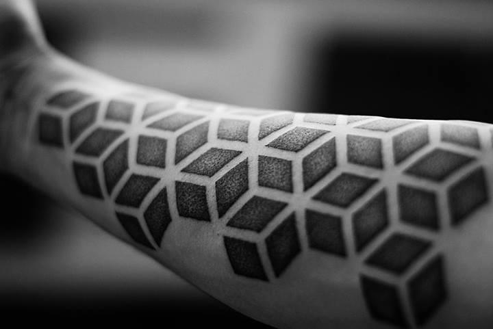 Geometric dotwork tattoo on the forearm