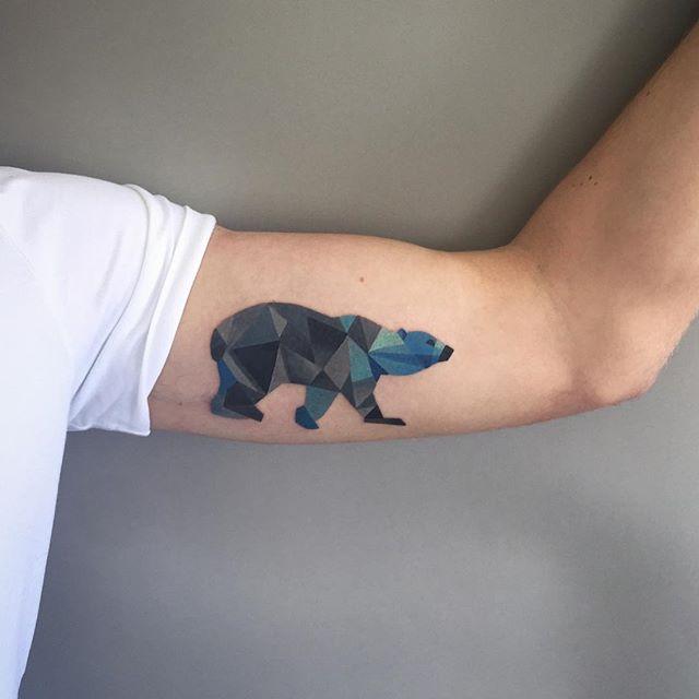Geometric polar bear tattoo on the bicep