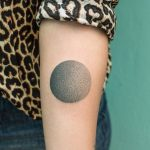 Gradient black circle tattoo