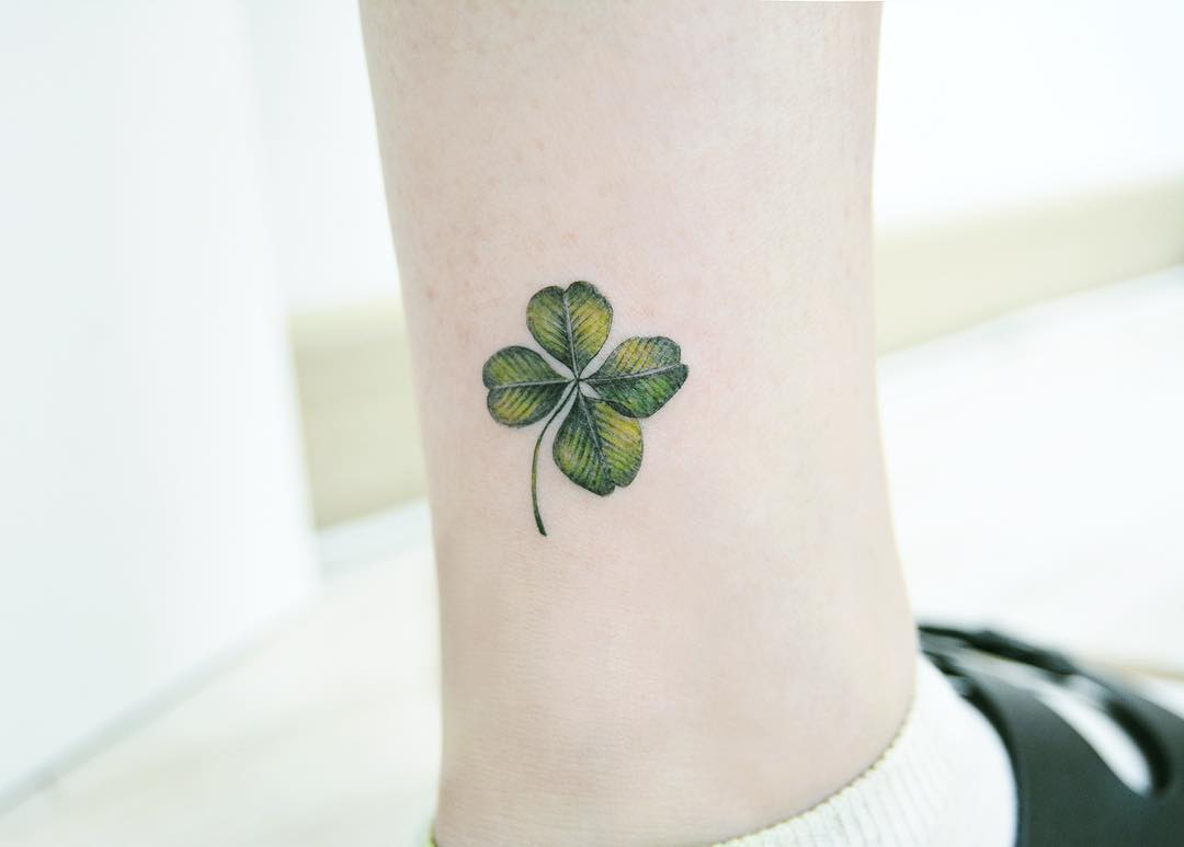 Green clover tattoo on the ankle