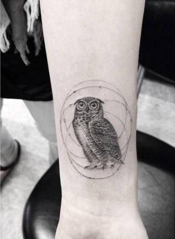Hand poked owl tattoo