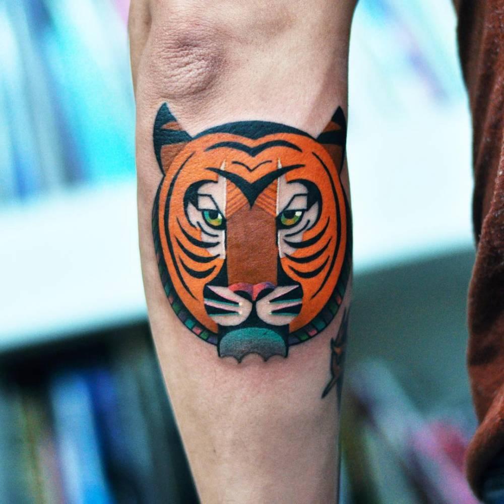 Head of a tiger tattoo