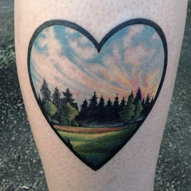 Hear shaped landscape tattoo