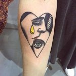 Heart shaped faces tattoo