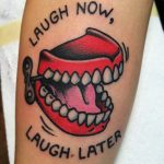 Laugh now laugh later tattoo