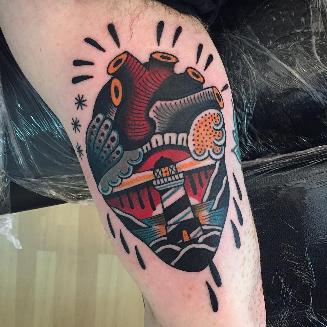 Lighthouse in a heart tattoo