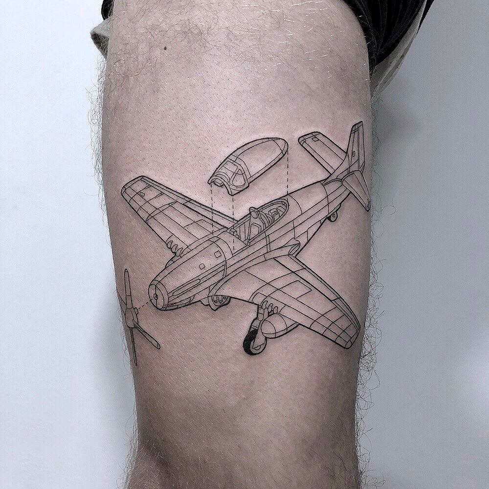 Linear black and grey airplane tattoo