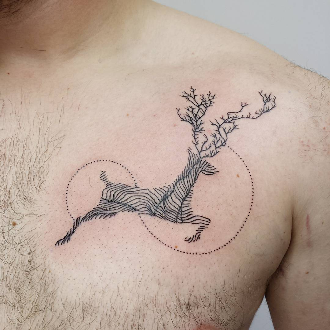 Linear deer tattoo on the chest