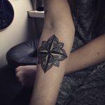 Mandala and nautical compass tattoo