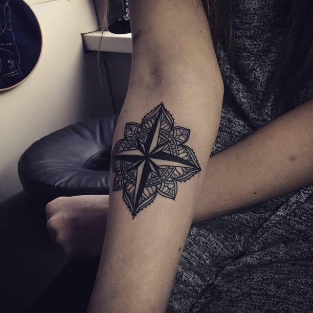 Mandala and nautical compass tattoo