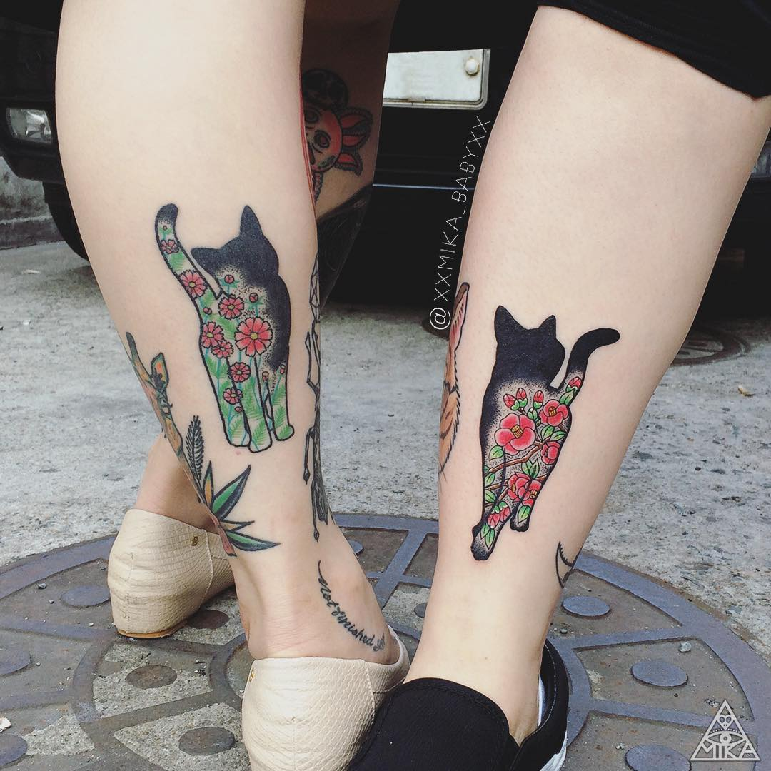 Matching floral cat tattoos