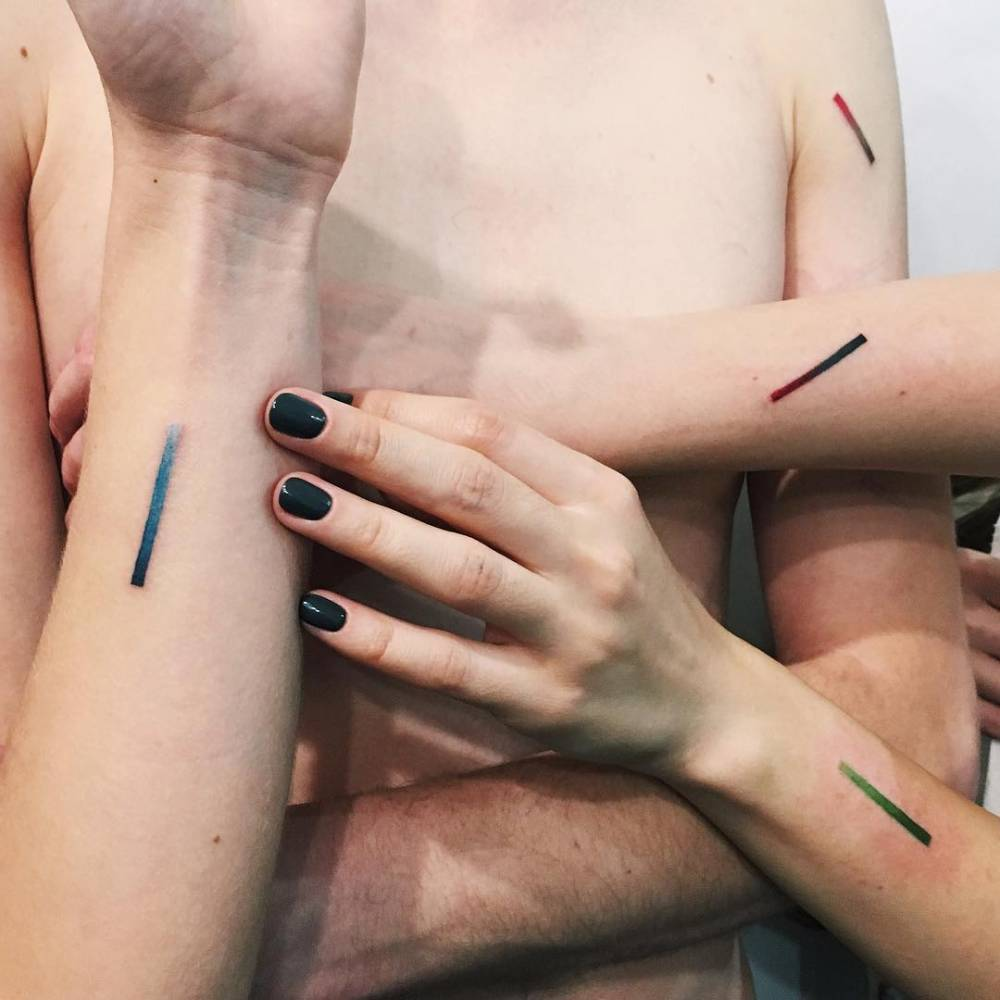 Matching gradient line tattoos