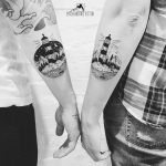 Matching lighthouse tattoos