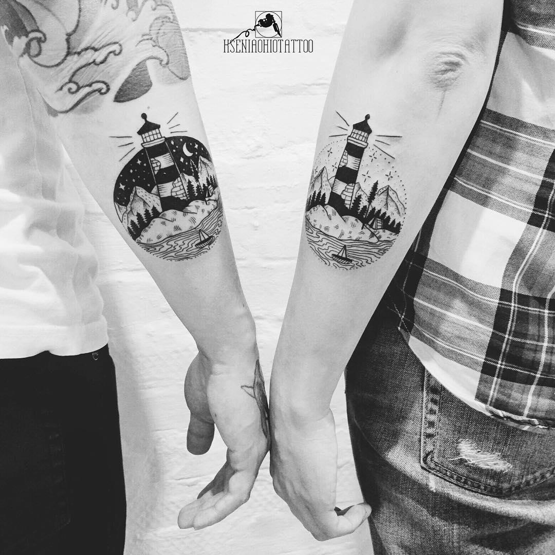 Matching lighthouse tattoos