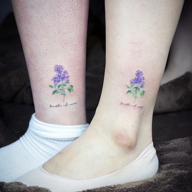 Matching lilac tattoos