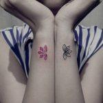 Matching lotus flower tattoos on wrists