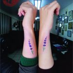 Matching violet flower tattoos