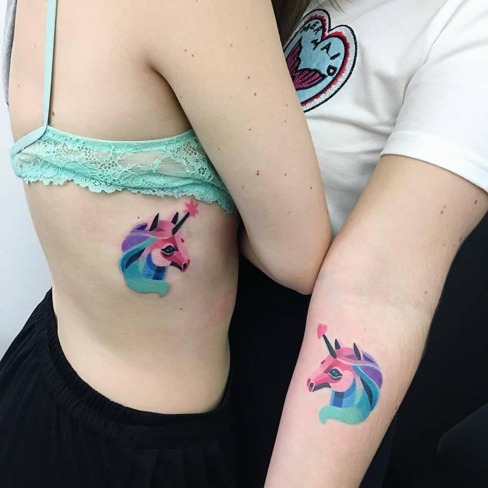 Matching watercolor unicorn tattoos