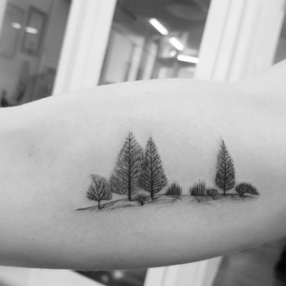 Minimal forest scenery tattoo