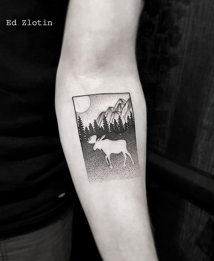 Negative space moose tattoo