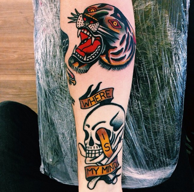 Old school skull and panther tattoos