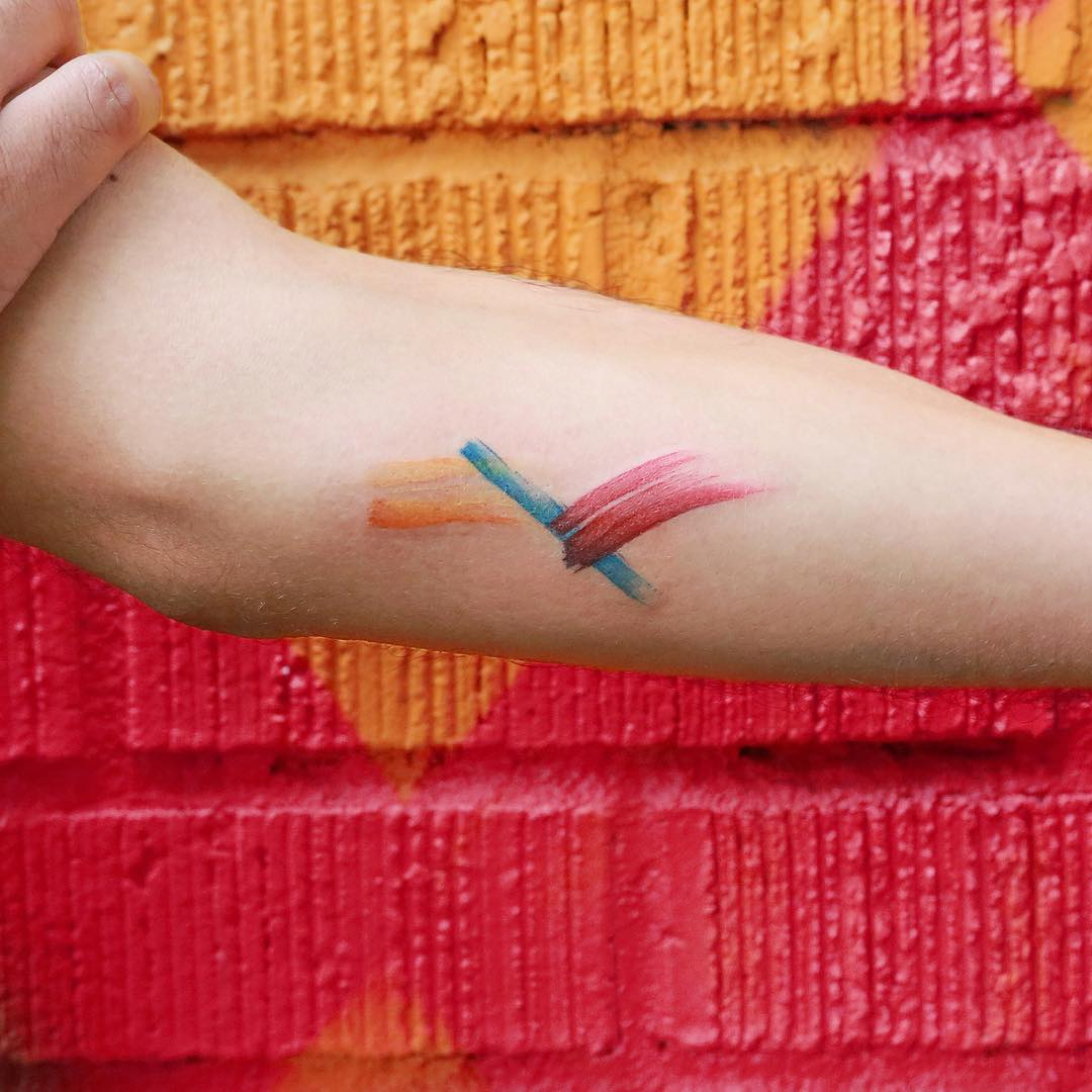 Orange blue and red abstract tattoo