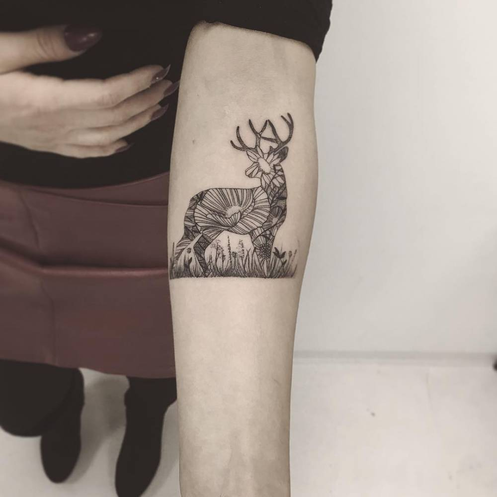 Ornamental deer tattoo