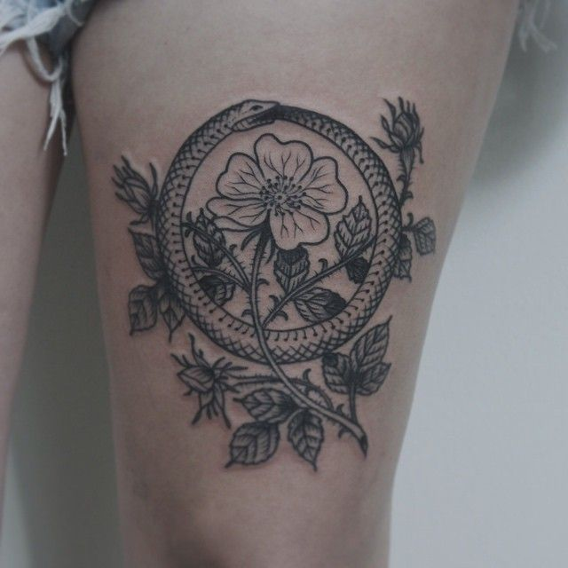 Ouroboros and flower tattoo