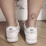Outline clover tattoo on the ankle