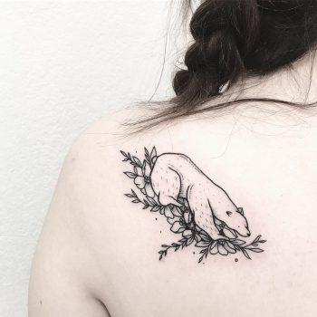 Polar bear tattoo on the left shoulderblade