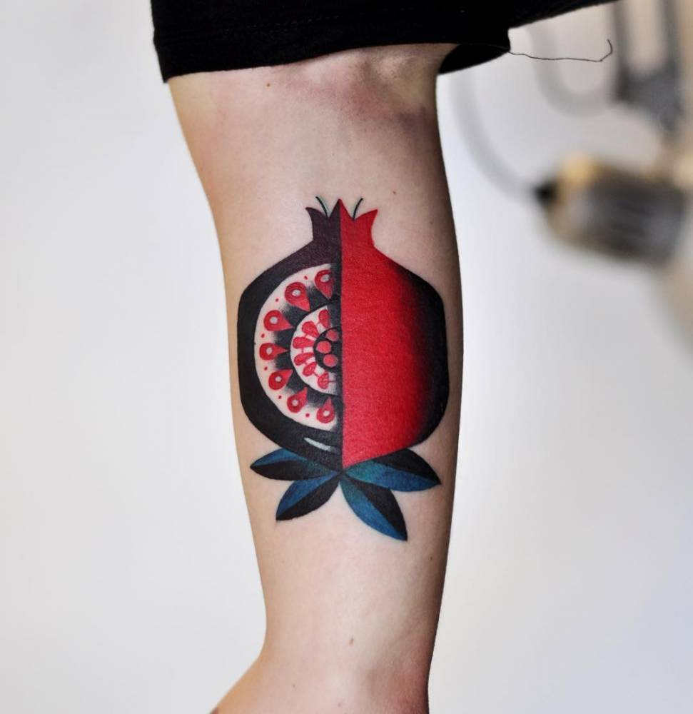 Pomegranate tattoo on the bicep