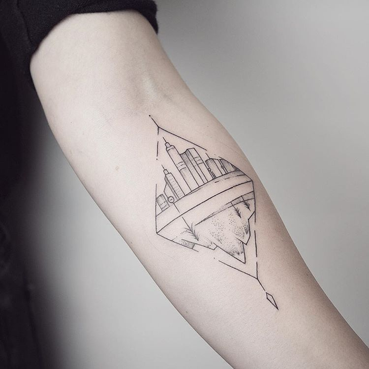 Rhombus shaped city and mountain tattoo