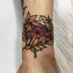 Ruby and golden branches tattoo