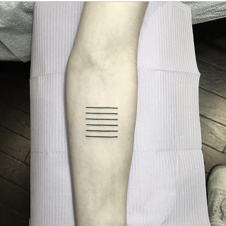 Six small lines tattoo