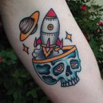 Skull and rocket tattoo
