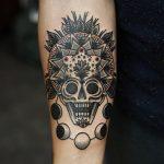 Skull mandala and moon phases tattoo