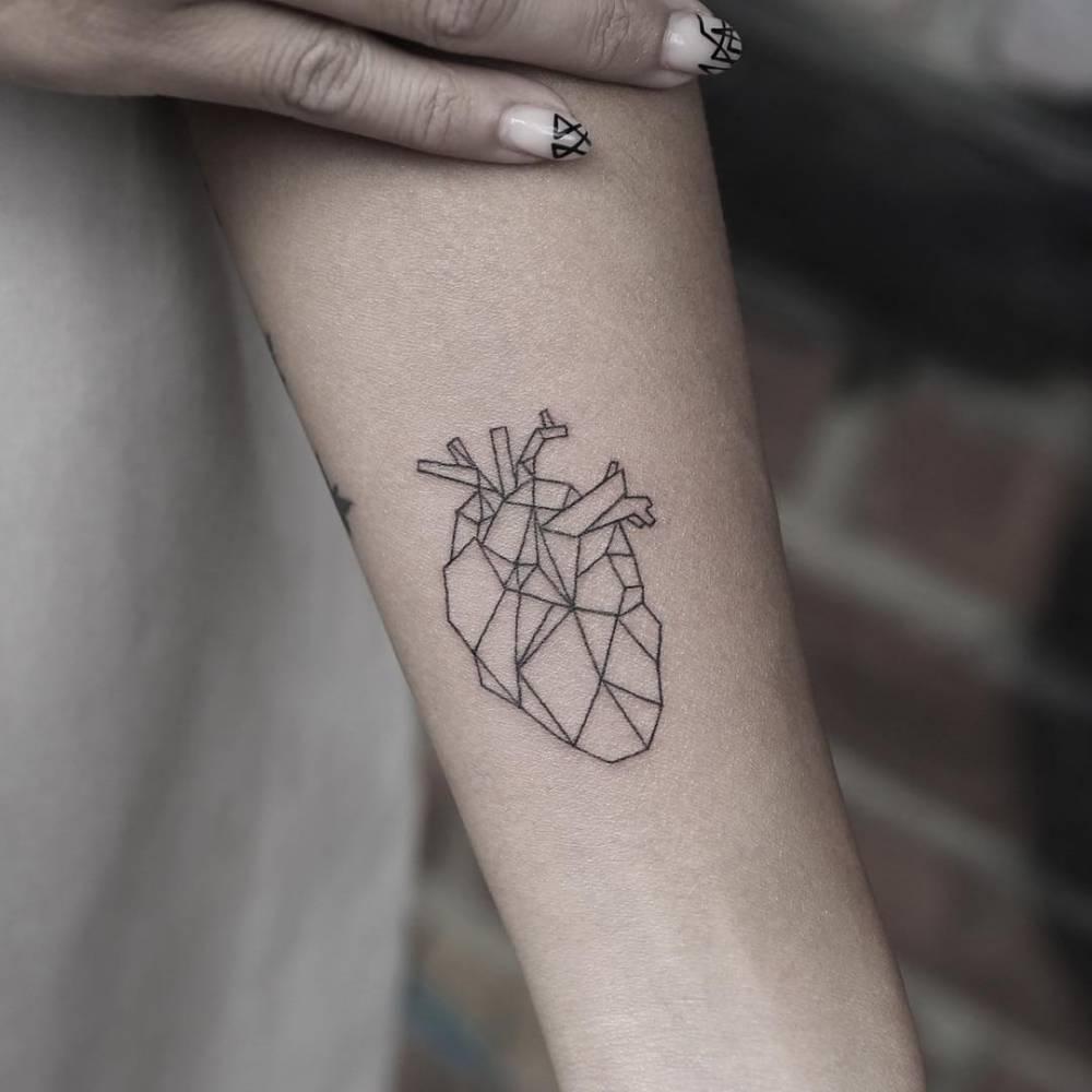 Small geometric heart tattoo