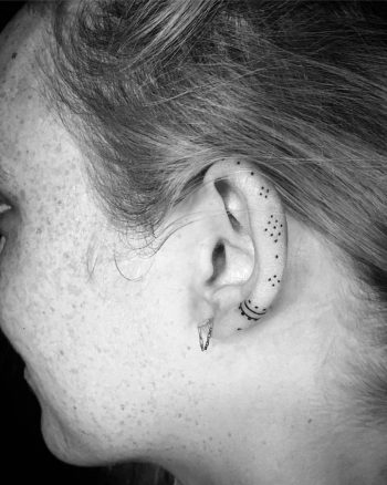 Small ornament tattoo on the ear