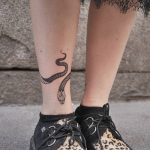 Snake tattoo on the right ankle