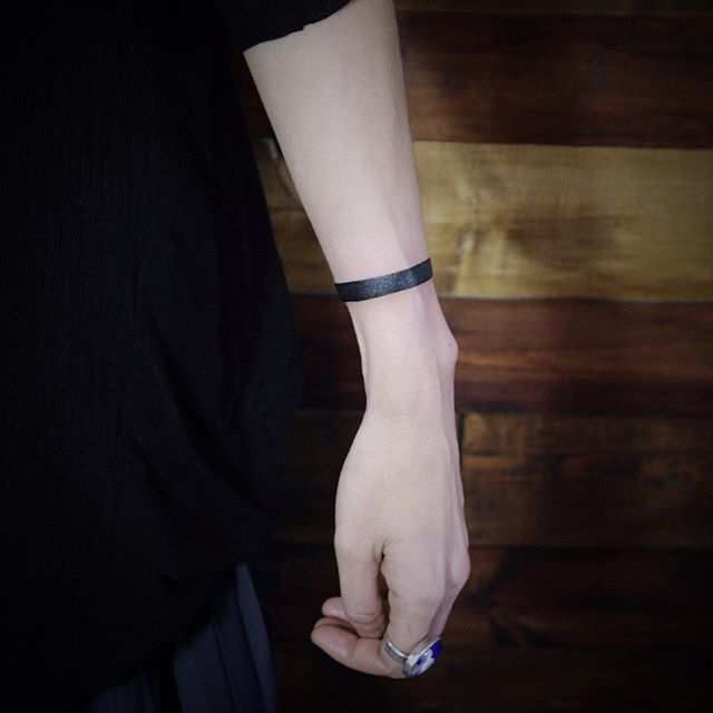 Solid black wristband tattoo