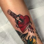 Stabbed heart and barbed wire tattoo