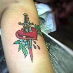 Stabbed heart tattoo on the bicep