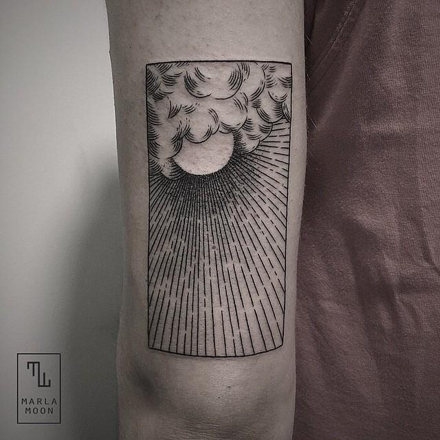 Sun in the clouds tattoo
