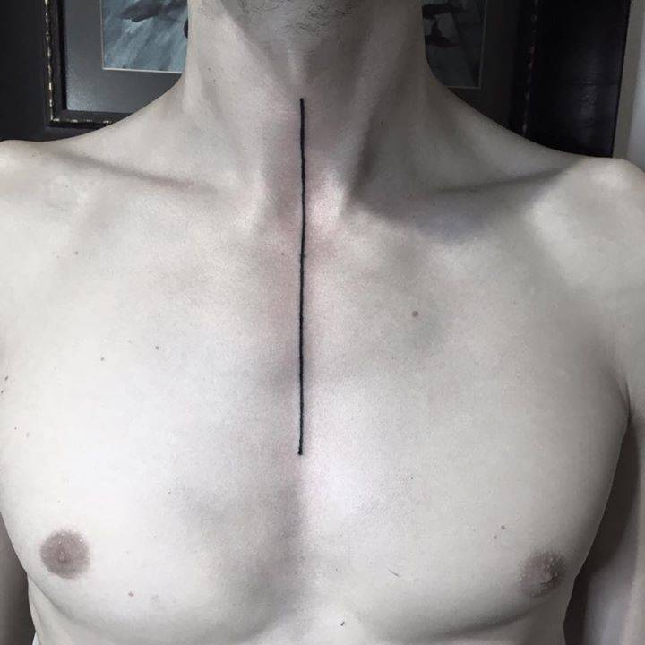 Thin black line tattoo on the chest