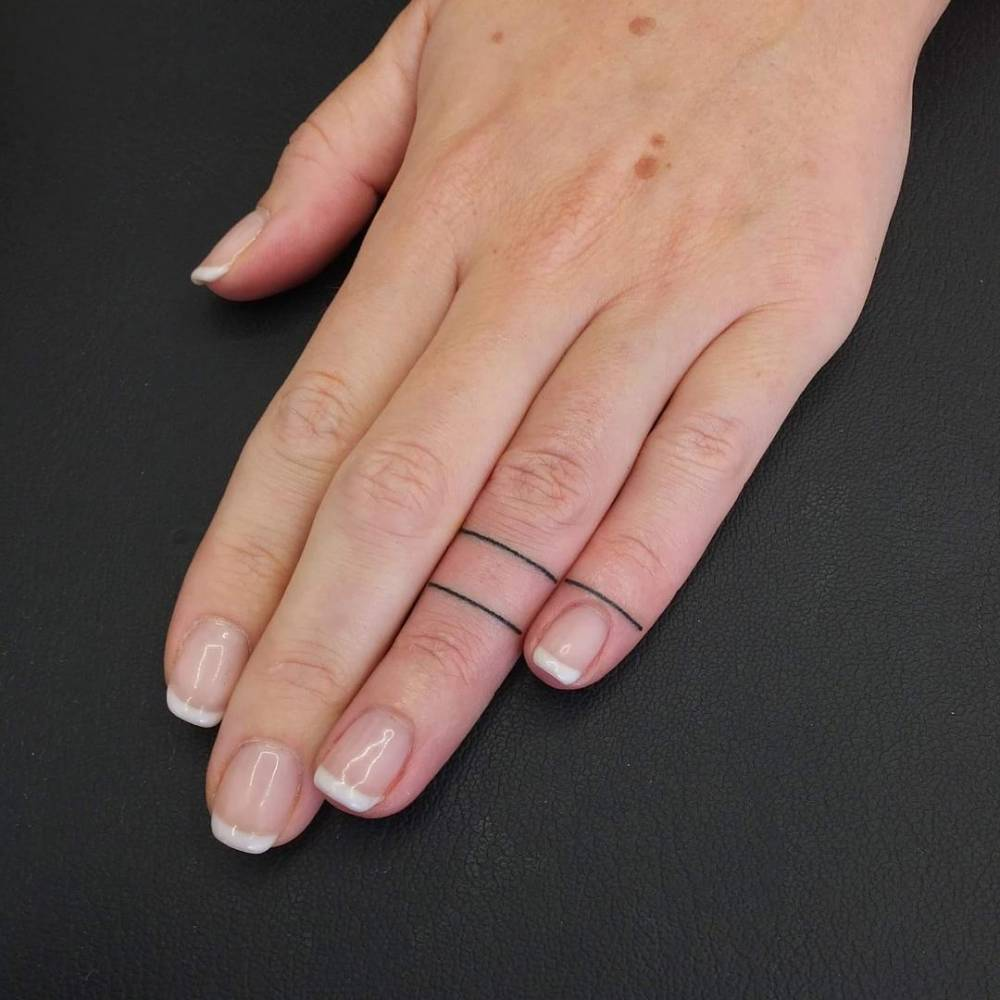 Thin line ring tattoo