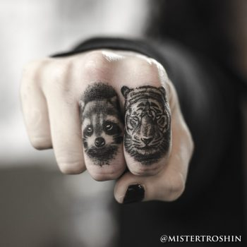 Tiger and raccoon tattoos on fingers