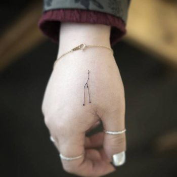 Tiny taurus constellation tattoo on the hand