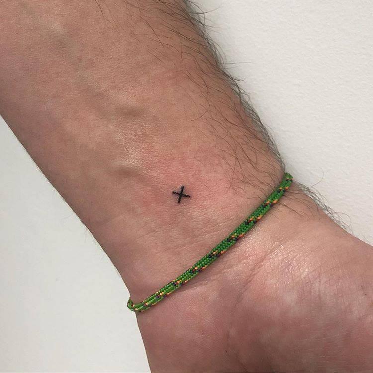 Tiny letter x tattoo